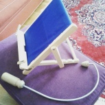 Book holder and self-massage tool.